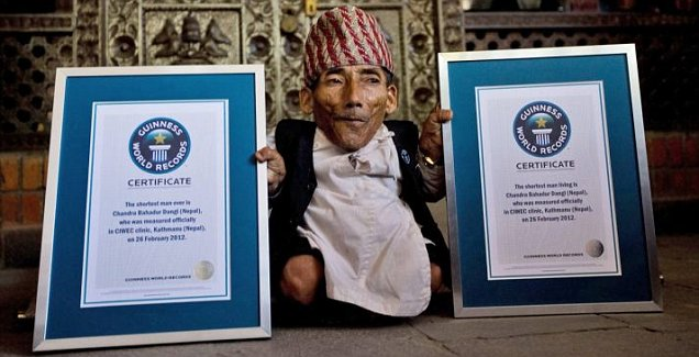 Nepalese man Chandra Bahadur Dangi poses for the media after he is officially recognised as the shortest man ever and shortest man living by Guinness World Records