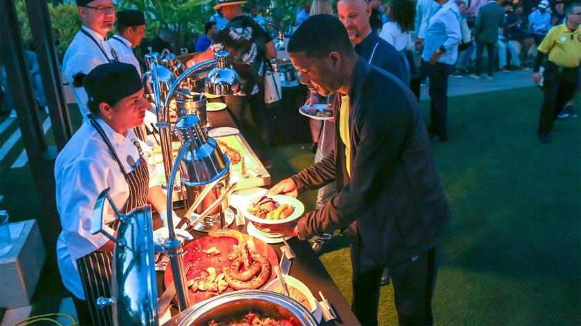 The food was as plentiful as the cigars and drinks, with sausages and flank steaks roasting on open-fire grills all night while servers at carving stations piled up as much beef as a plate could hold.