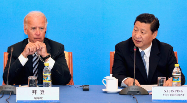 Then Chinese Vice Chair Xi Jinping (R) speaks during talks with then U.S. Vice President Joe Biden