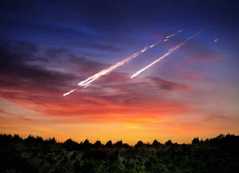 Imagen muestra arte que simula meteoritos descendiendo hacia la Tierra