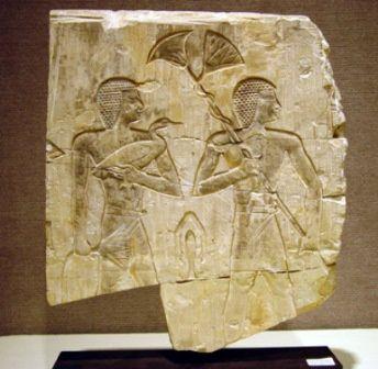 The Egyptian,represent themselves as African, dark skin, kinky hair