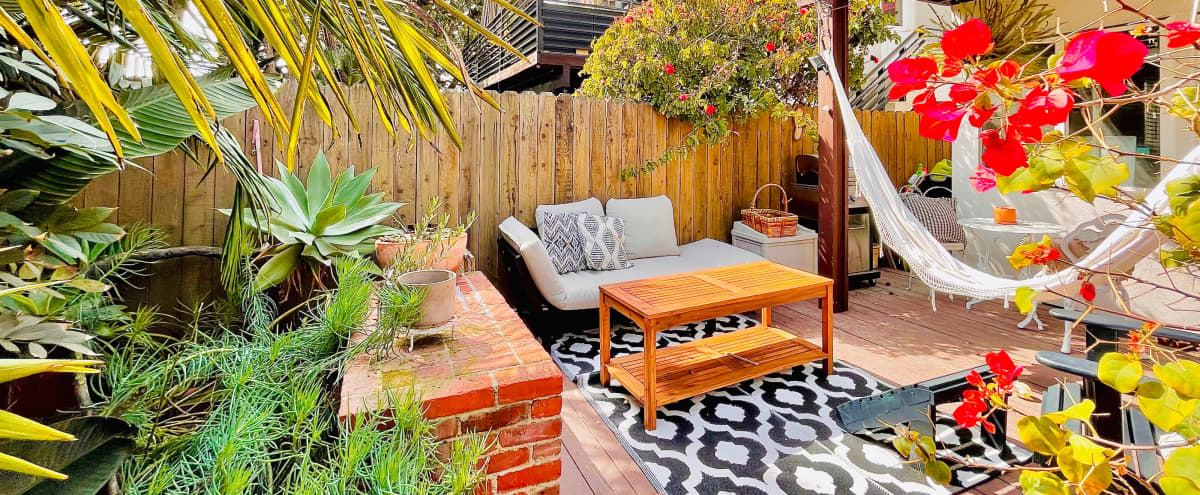 steps to beach outdoor patio with hawaiin jungle vibes outdoor studio backdrop available