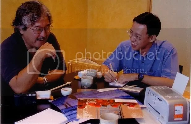 Me in blue shirt interviewing Michael Yamashita