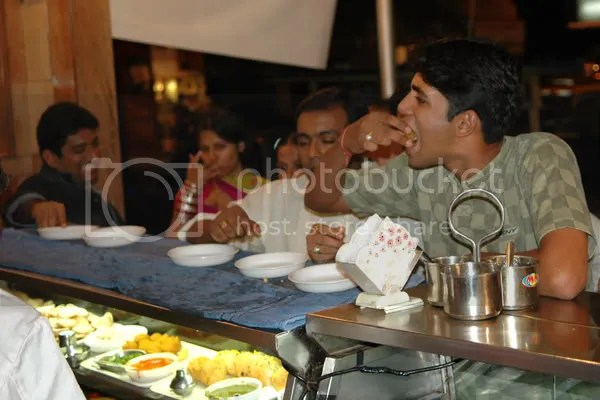How to eat Paani Puri at Kailash Parbat Pics by Arun Shanbhag