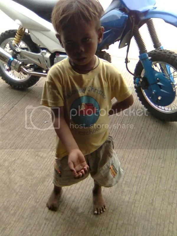 Beggar boy -- he wasn't very happy. :( Pictures, Images and Photos