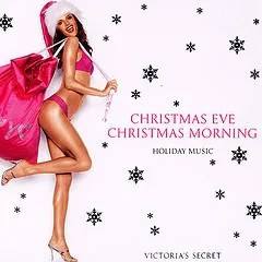 Cover of the Victoria's Secret holiday compilation, which depicts a thin woman dressed in hot pink underwear, high heels and a Santa hat toting a large sack of gifts into the frame. She looks very happy.