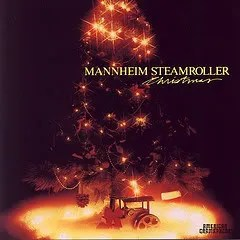 "Cover of Mannheim Steamroller's album ""Christmas,"" which shows a painting of a decorated, soft-focus holiday tree in dim light."