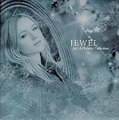 "Cover of Jewel's album ""Joy: A Holiday Collection,"" which depicts the singer in some sort of heavily-edited, blue/gray tinted winter wonderland."