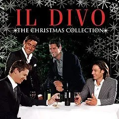 "Cover of Il Divo's album ""The Christmas Collection,"" which depicts four young men in suits gathered around a table. They appear to be enjoying some alcohol."