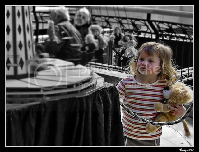 girl looking at toy