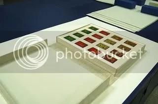 Card trays in custom clamshell box.