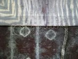 Geraldine McCulloch - Two pieces of cloth dyed using the Shibori technique from an Indigo Shibori workshop with Barbara Schey. One piece was cotton voile which was sewn and bound and the other was crinkled cotton which was folded and wrapped around a pole.