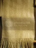 Sue Rogers - A cream coloured handwoven scarf made with fine wool and silk from a pattern from 'Handwoven' magazine.