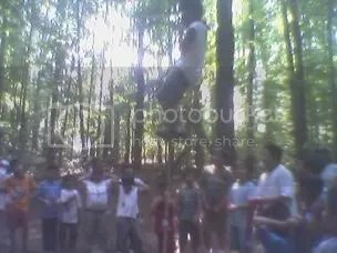one of the kids climbing the rope