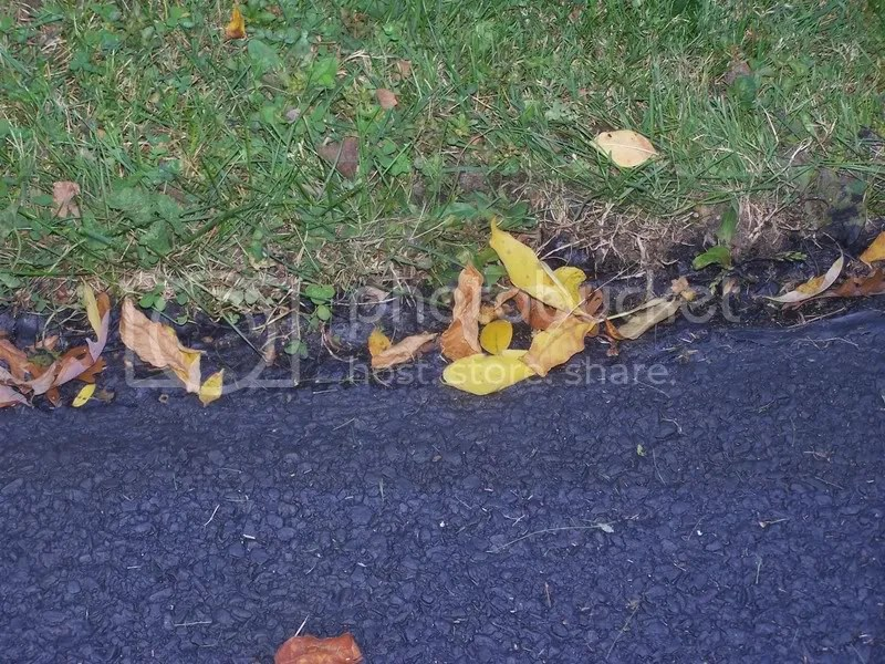 lawnmower blade breaking lumps of tar