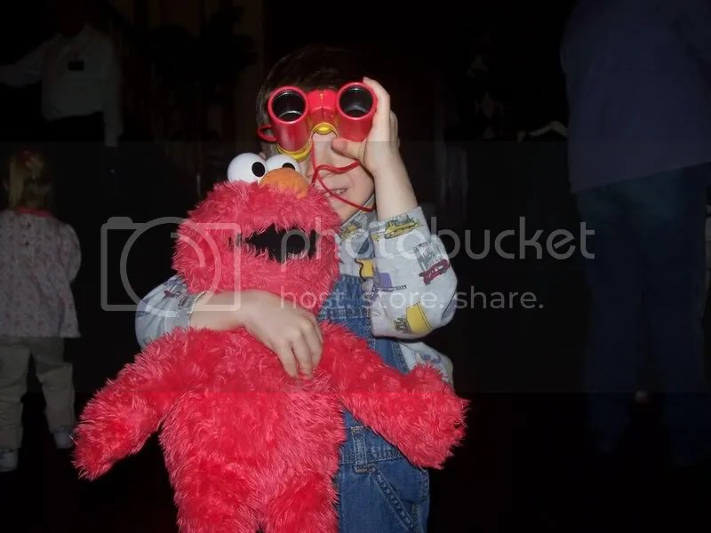This is _the_ shot. Monkey, Elmo and a pair of binoculars. Does it get better than this?