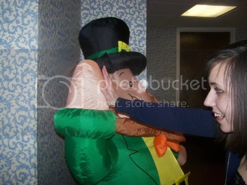 She was high fiving the leprechaun blow up...