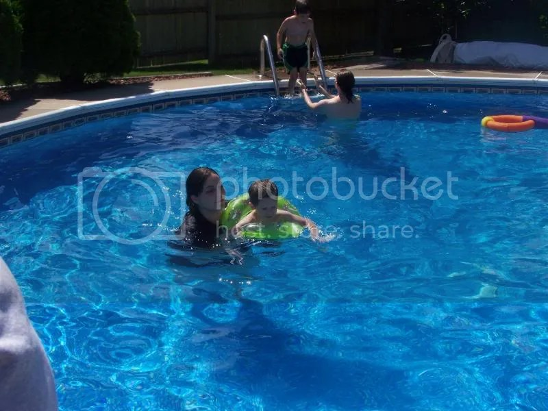Isaac and DiAnna swimming in the big pool