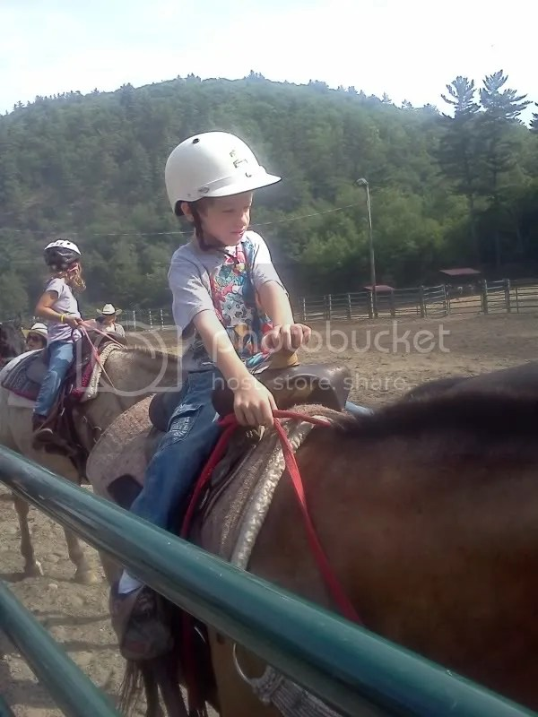 Small boy plus big horse equals the need for lessons!