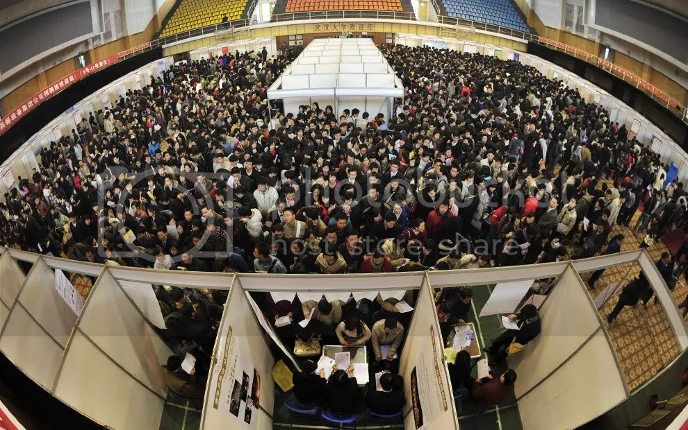 Thousands of unemployed Chinese graduates flock to a job fair in Wuhan, central Chinas Hubei province on March 7, 2009. China vowed to help train one million graduates in the next three years to boost their qualifications, and promised loans to business that hire graduates, as unemployment continues to grow. (STR/AFP/Getty Images)