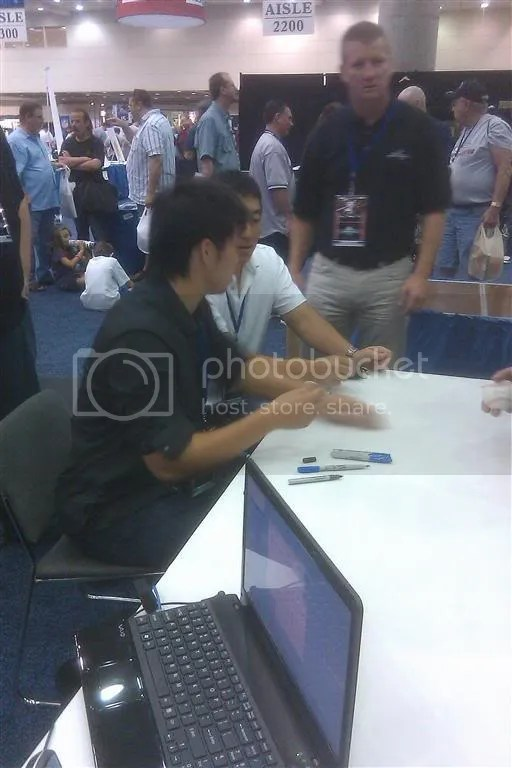 Tazawa signing at the Freedom Cardboard Booth