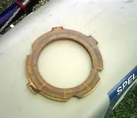 What was left of the friction plate, should have 6 equal lugs on outer rim