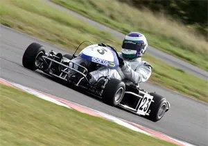 Jason showing the youngsters how its done - 250cc Superkart