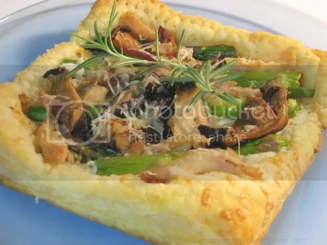 A puff pastry tart with shitake mushrooms, asparagus, cheese, and shredded rotisserie chicken.