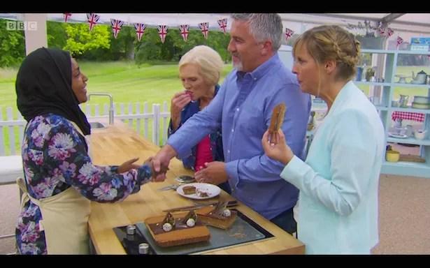 Paul shakes Nadiya's hand