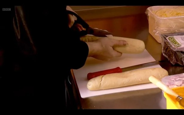 Just doin' this now. Scissoring a baguette.