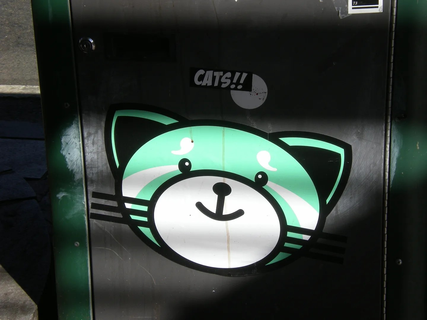 green cat street art sticker