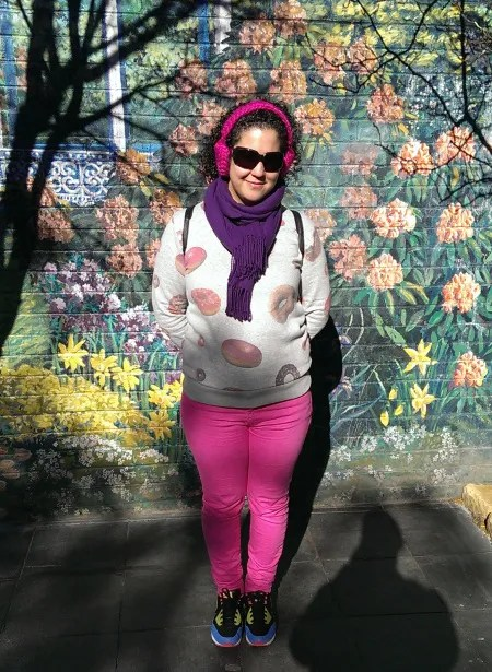 plus size outfit gray donut sweatshirt, pink skinny jeans, and purple scarf