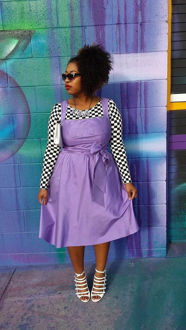 plus size outfit with lilac dress and checkerboard print black and white shirt
