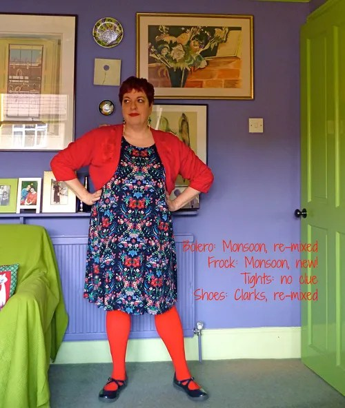 plus size outfit with russian floral dress, red bolero, and red tights