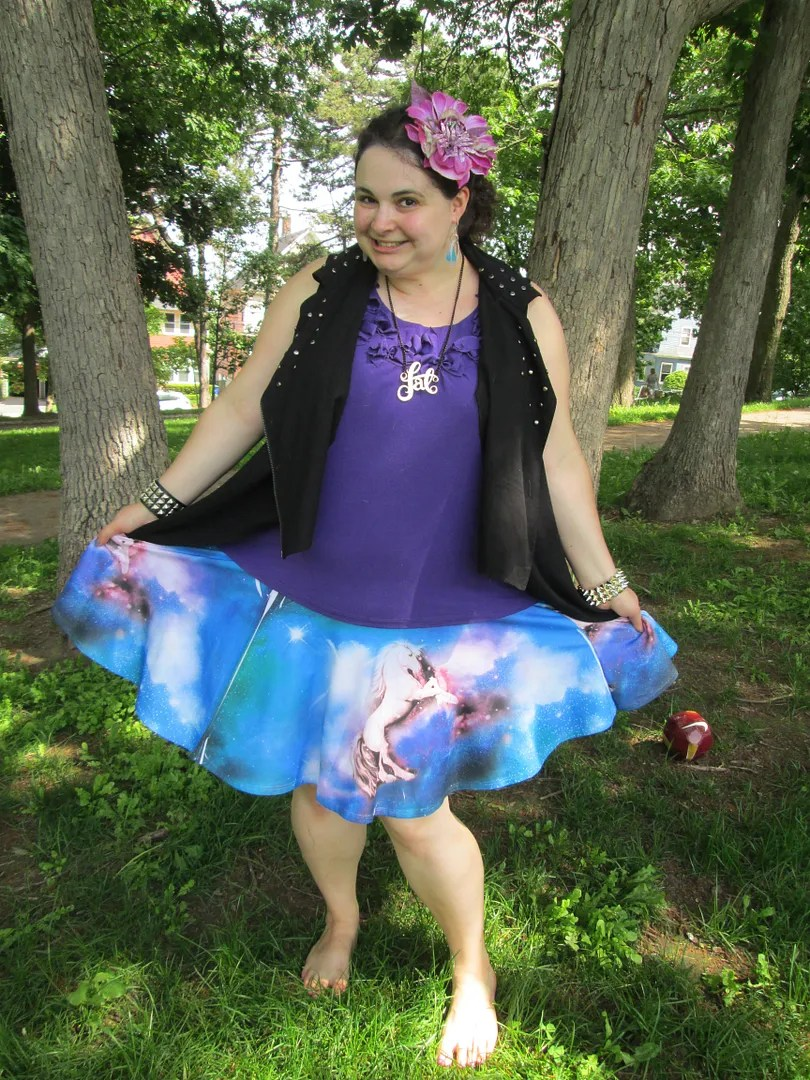 unicorn skirt, purple tank, and punk vest outfit