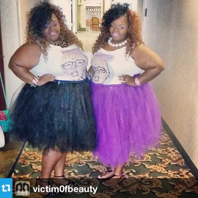 two sisters wearing beyonce t-shirts and tutus, one purple and one black
