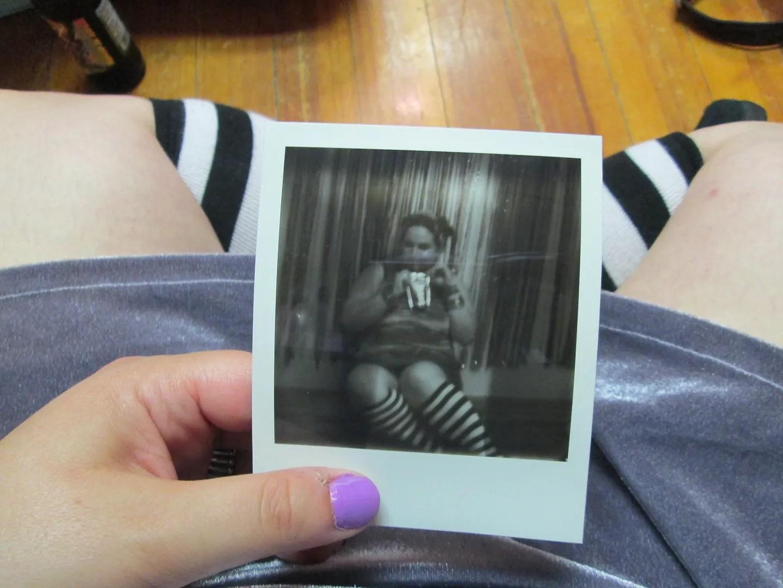 polaroid picture of me drinking a capri sun