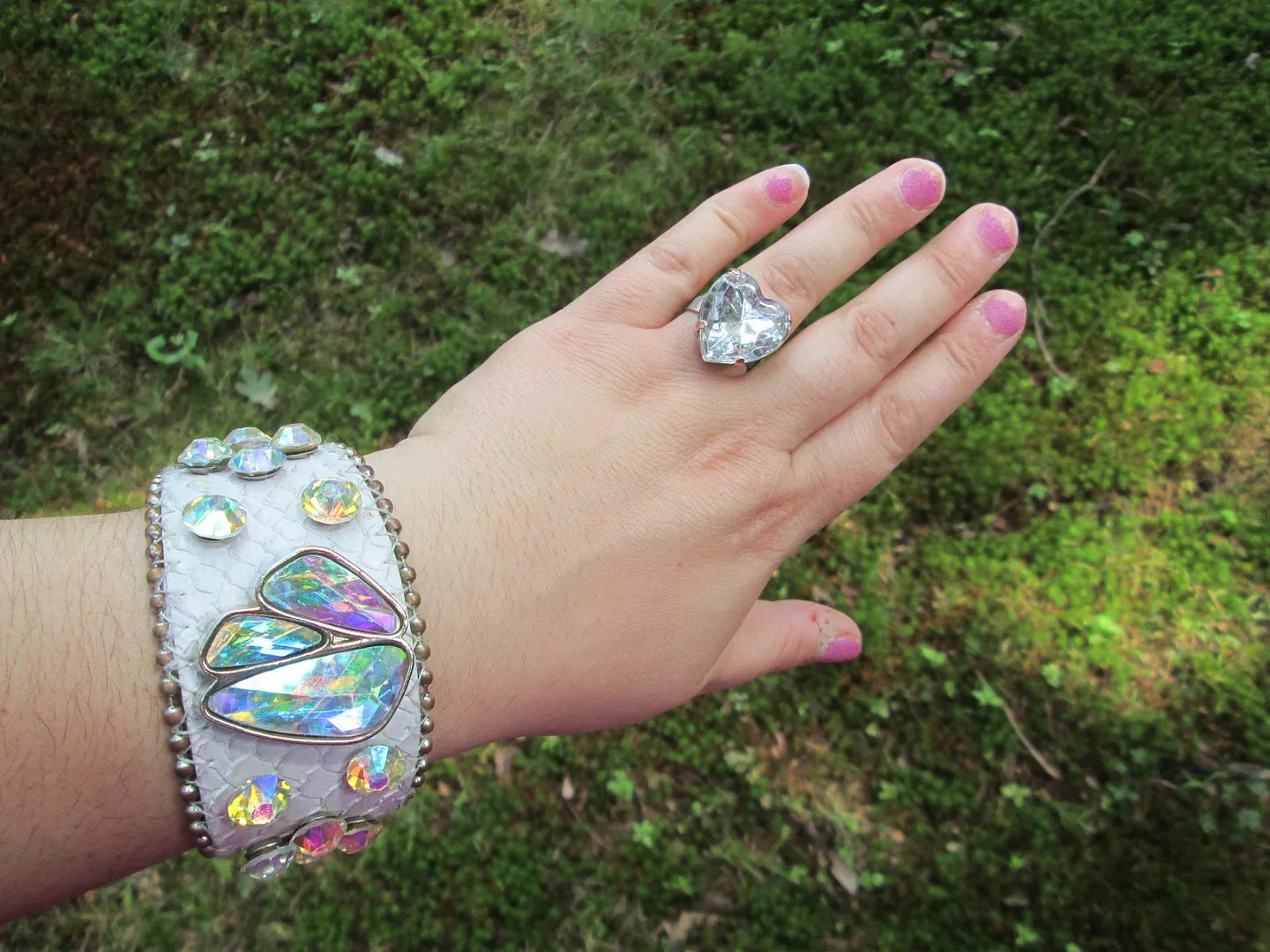 white wristband with rhinestones and big heart rhinestone ring