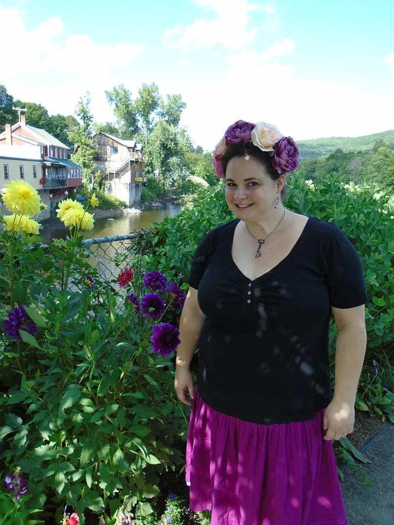 plus size outfit on flower bridge - magenta skirt, black top, rose flower crown