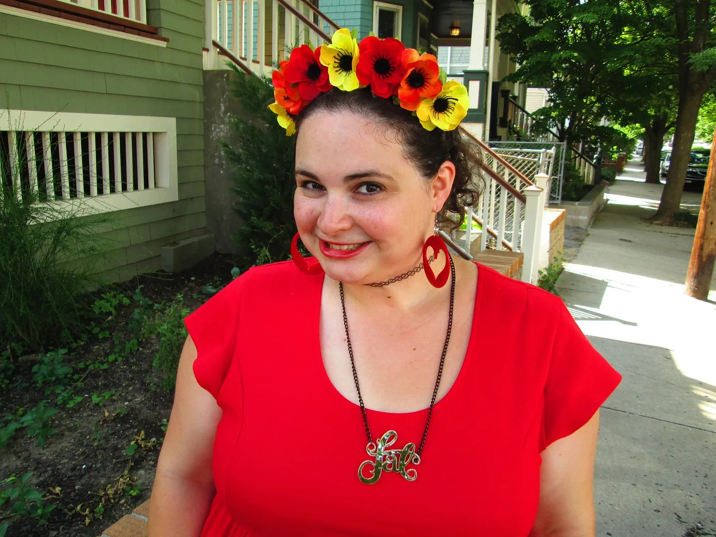 plus size outfit red dress with fat necklace and anemone crown