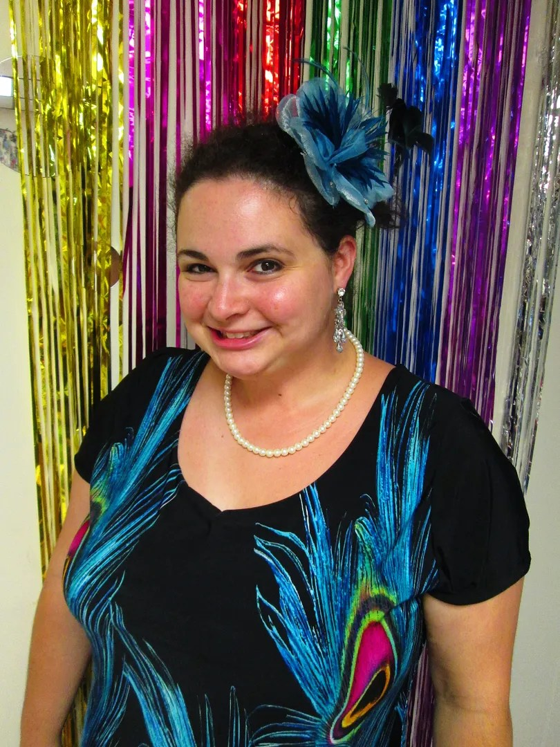 plus size peacock dres and turquoise fascinator