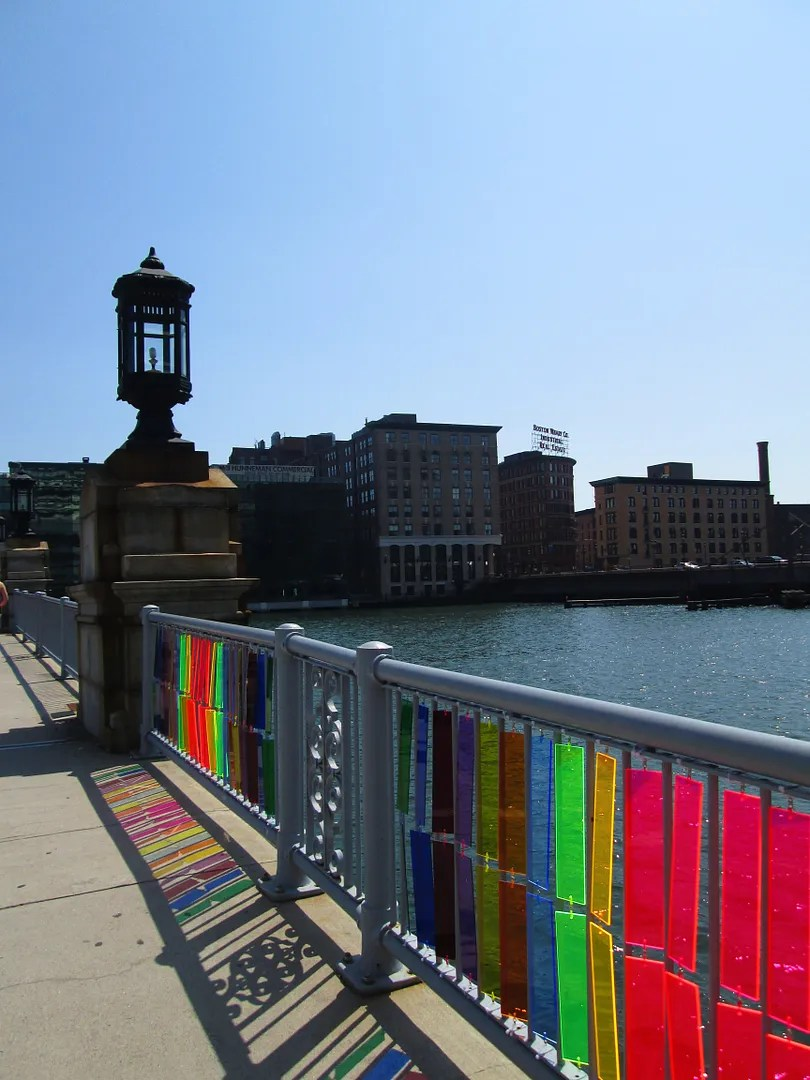 plexiglass rainbow panels attached to bridge in boston