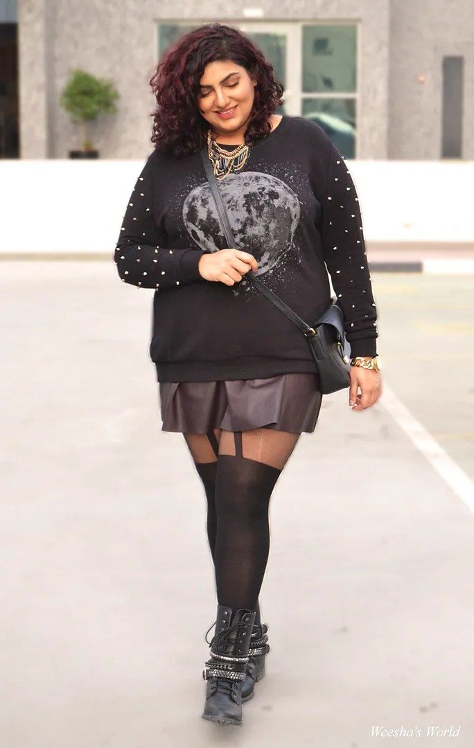 plus size punk outfit with leather miniskirt, moon sweater, spike necklaces