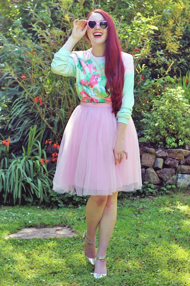 outfit with light pink tulle tutu skirt, my little pony sweater, and pink heart-shaped sunglasses