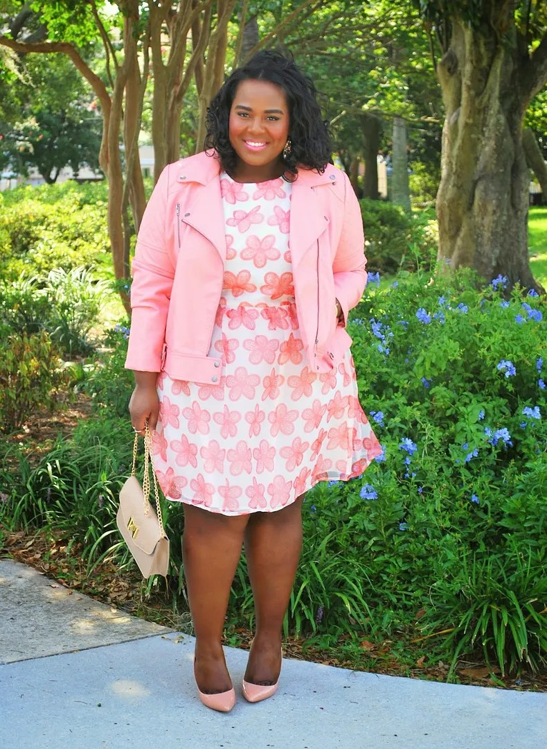 plus size outfit pink and white floral dress and pink leather moto jacket