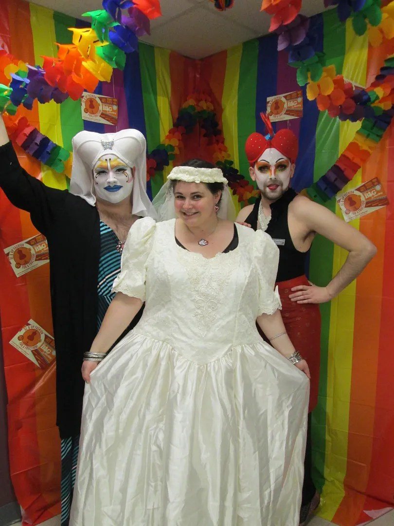 woman wearing 80s wedding dress with two queer nuns