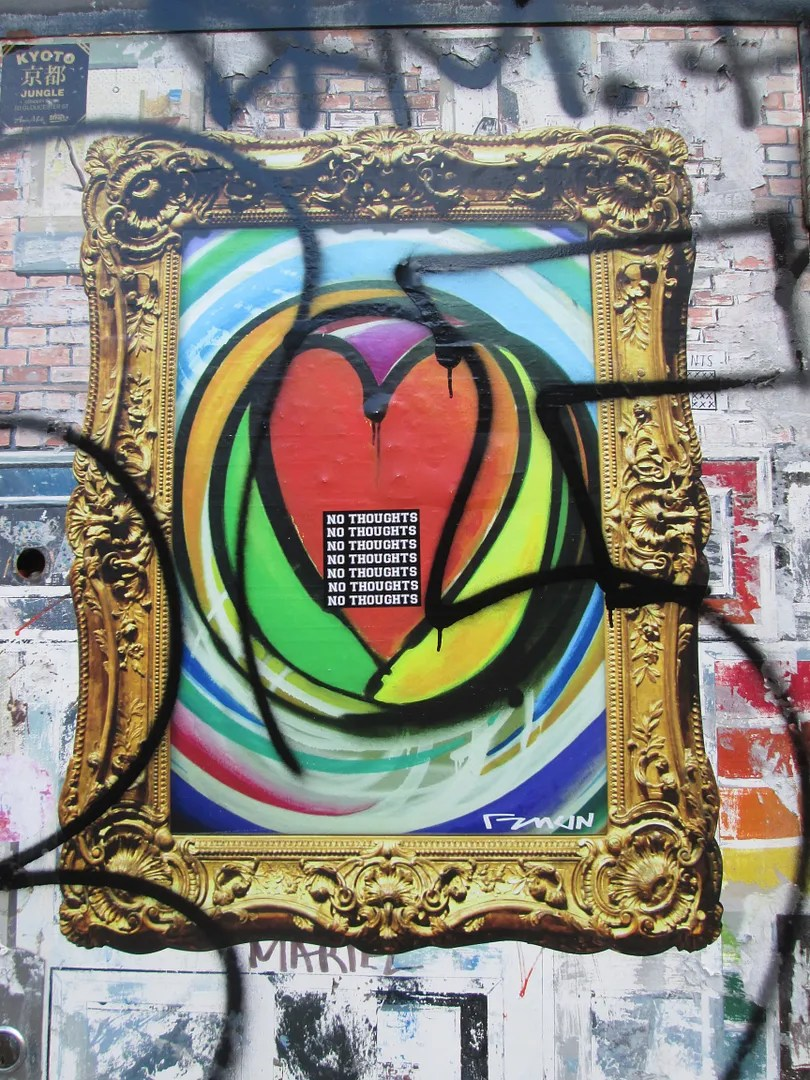 street art of colorful heart in a gold frame