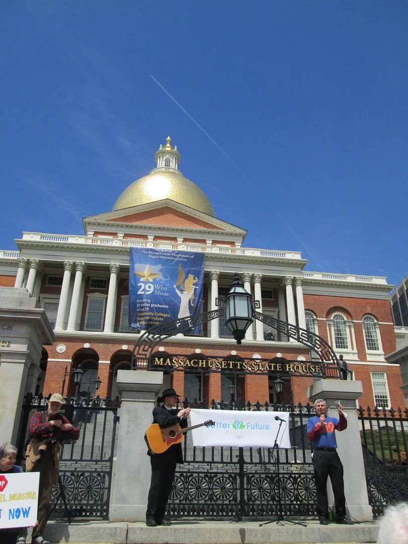 malcolm bliss speaking at fossil fuel divestment rally in front of massachusetts state house