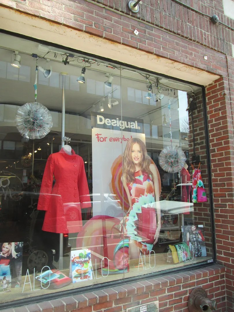 picture of desigual store window with sign that says