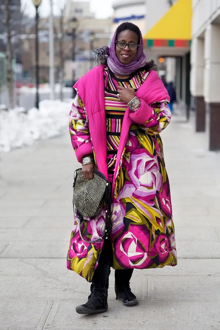 older woman wearing bright pink, green, and black missoni outfit